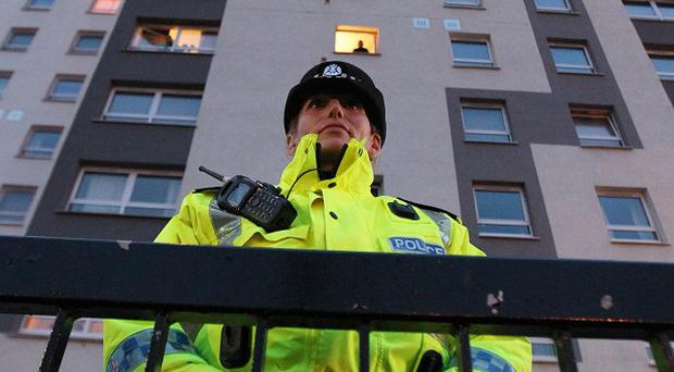 A man arested at flats in Whiteinch, Glasgow, has been charged with terror offences