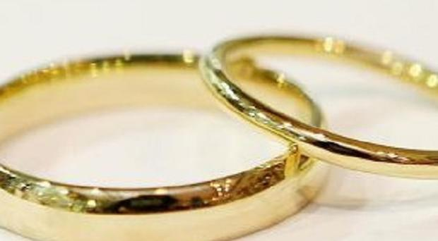 Two clergymen have been charged following a sham marriages probe