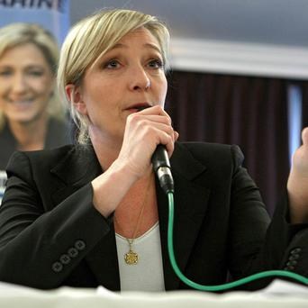 Leader of the French far right party National Front, Marine Le Pen, has visited an illegal migrant centre in Italy (AP)