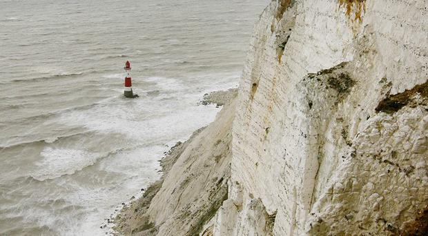 A man and woman have died near Beachy Head in what police said was likely to be a 'murder suicide'