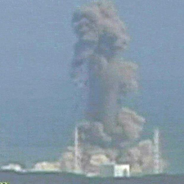 Smoke rises from the Fukushima Dai-ichi nuclear plant's Unit 3 (AP)