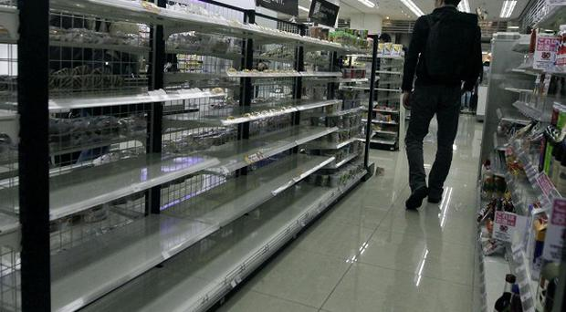 Japanese stores are empty after panic-buying following the earthquake and tsunami (AP)