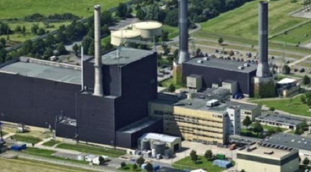 Germany will take seven of its 17 nuclear reactors offline for three months, Chancellor Angela Merkel has announced (AP)