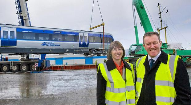 Translink group chief executive Catherine Mason and Regional Development Minister Conor Murphy see the new trains unloaded in Belfast