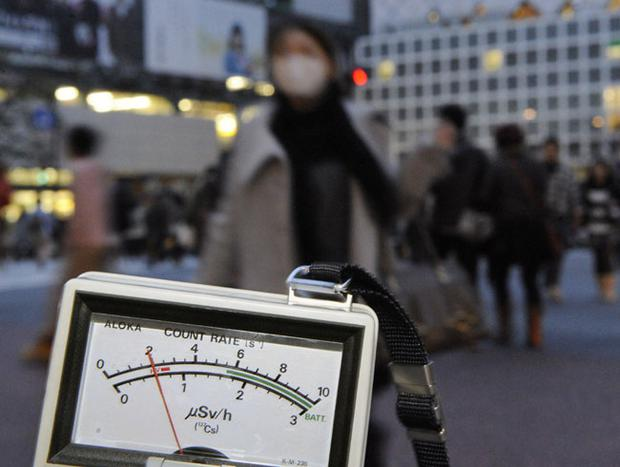 A radiation detector is used near Shibuya train station in Tokyo