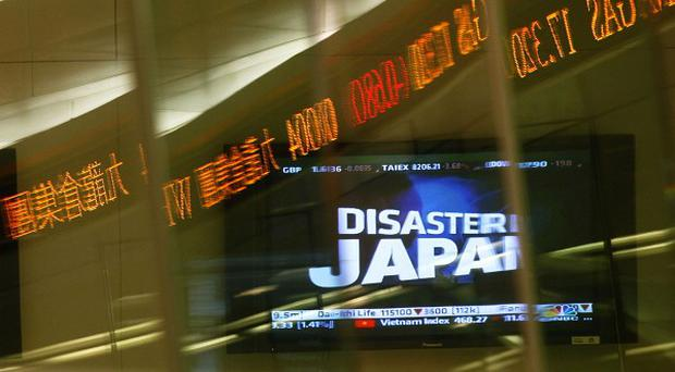 Japanese stocks recovered some of the massive losses sustained following a devastating earthquake and tsunami