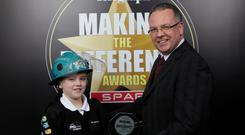 999 Hero presented by Liam McIvor, CEO Northern Ireland Ambulance Service to winner Glen Wray.