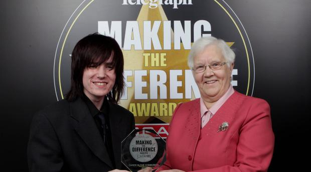 Carer in the Community presented by Baroness May Blood to winner Adam Kaleta.