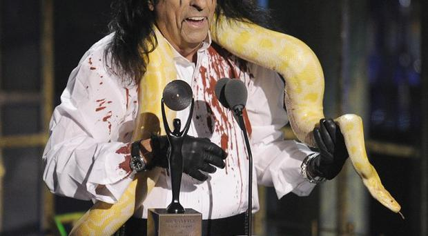Alice Cooper with a snake around his neck at the Rock and Roll Hall of Fame induction ceremony