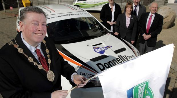 Welcoming Lisburn's new role in the Circuit of Ireland Rally are Lisburn Mayor, Alderman Paul Porter, Roisin Donnolly of the Donnelly Motor Group, Jenny Palmer of the Economic Development Committee, David Dornan, General Manager of UTV Drive, and Jim Dillion of the Economic Development Committee