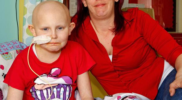 Chloe Challoner, nine, who had her mobile phone stolen from her hospital room, seen here with mum Becky