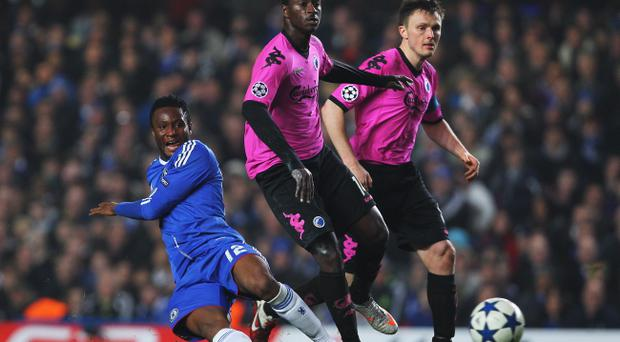 LONDON, UNITED KINGDOM - MARCH 16: Jon Obi Mikel (L) of Chelsea is challenged by Dame N'Doye (C) of FC Copenhagen during the UEFA Champions League round of sixteen second leg match between Chelsea and FC Copenhagen at Stamford Bridge on March 16, 2011 in London, England. (Photo by Clive Rose/Getty Images)