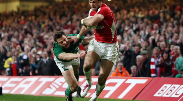 Mike Phillips, seen fending off Tommy Bowe on his way to his controversial try, was happy to take his 'slice of luck'