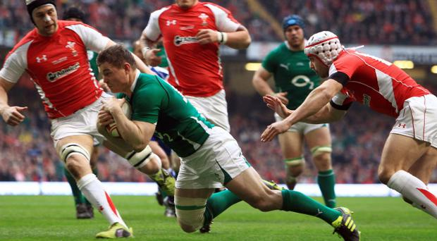 Ireland's Brian O'Driscoll scores a try against Wales last weekend