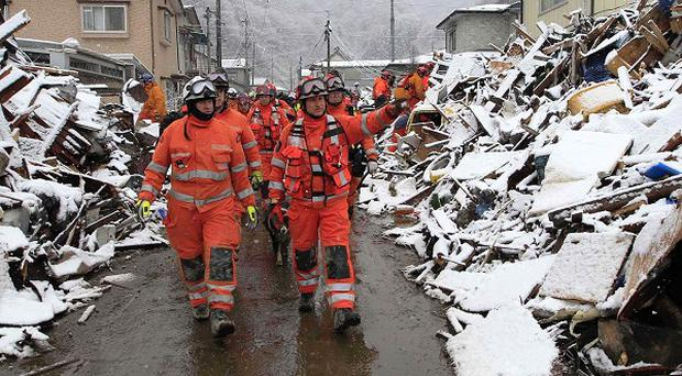 A British search and rescue team has been sent to aid relief efforts in Japan (AP)