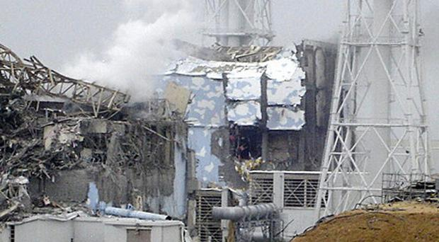 White smoke billows from the No 3 unit at the Fukushima power plant (AP Photo/Tokyo Electric Power Co via Kyodo News)