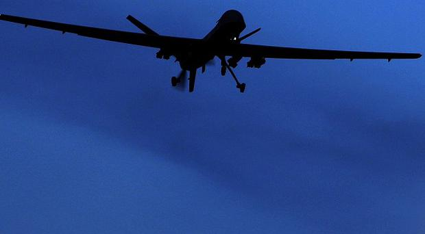 More than 30 suspected militants have been killed in a missile strike by a US drone in Pakistan (AP)