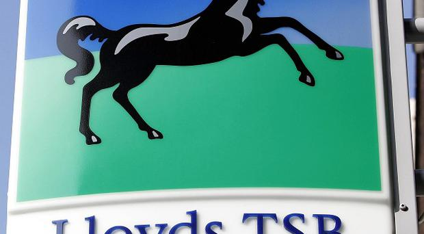 Lloyds is to axe 570 jobs and outsource more than 560 more, it has announced