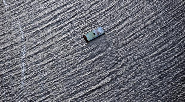 PACEMAKER BELFAST 25/11/09Sever flooding in Co Fermanagh from the air. Farm land and out buildings were worst affected in this area. A barn lies completely surrounded by floodwaters near Kerrybridge, County Fermanagh.Photo Colm Lenaghan/Pacemaker
