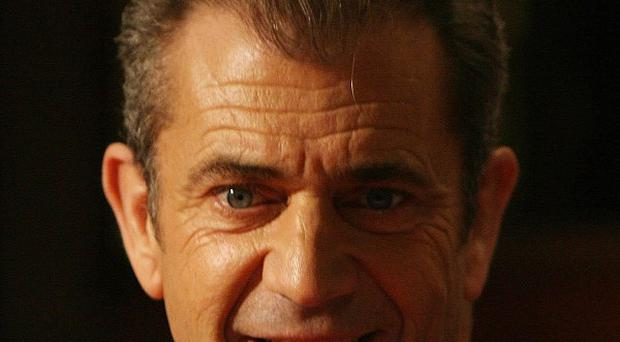 Hollywood Mel Gibson turned himself in as part of his plea deal