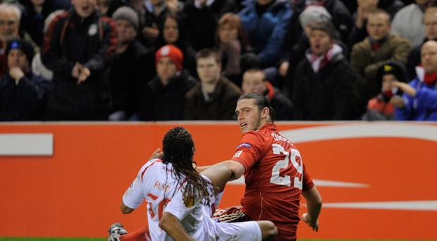 LIVERPOOL, ENGLAND - MARCH 17: Alan of SC Braga and Andy Carroll of Liverpool argue after a tackle during the UEFA Europa League Round of 16 second leg match between Liverpool and SC Braga at Anfield on March 17, 2011 in Liverpool, England. (Photo by Michael Regan/Getty Images)