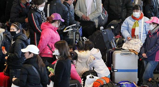 The Foreign Office has said the evacuation of Britons from Japan will begin on Friday evening (AP)