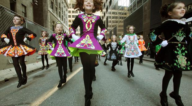 Girls from the Parents and Students of Irish Dancing and Music Association practice before the start of the 250th annual St. Patrick's Day parade March 17, 2011 in New York City.