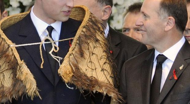 Prince William wears a Maori cloak as he chats with New Zealand prime minister John Key (AP)
