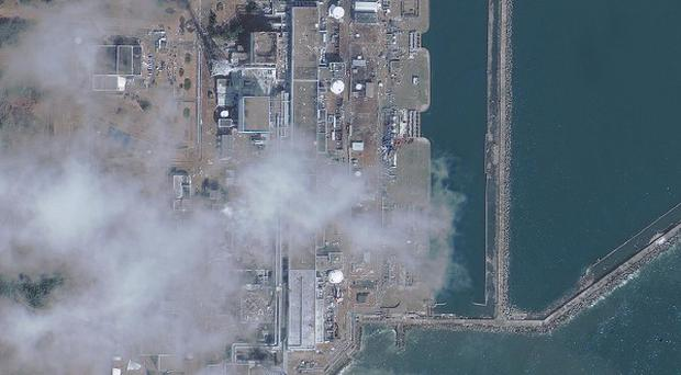 A satellite image of the Fukushima Dai-ichi nuclear power plant, where the severity of the incident has been raised from Level 4 to Level 5 (AP)