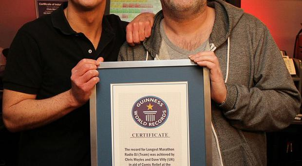 DJ Chris Moyles, right, and sidekick 'Comedy' Dave Vitty after their marathon radio show
