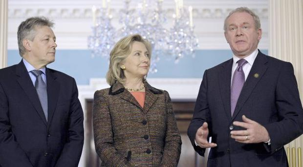 US Secretary of State Hillary Clinton, accompanied by First Minister Peter Robinson and Deputy First Minister Martin McGuinness, speaks to reporters at the State Department in Washington yesterday AP/Cliff Owen