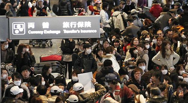 The evacuation of Britons from Japan is gathering pace (AP)