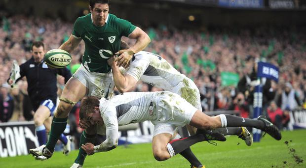 DUBLIN, IRELAND - MARCH 19: David Wallace of Ireland is tackled by Toby Flood and Chris Ashton of England during the RBS 6 Nations match between Ireland and England at the Aviva Stadium March 19, 2011 in Dublin, Ireland (Photo by Shaun Botterill/Getty Images)