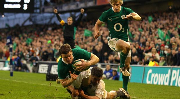 DUBLIN, IRELAND - MARCH 19: Ireland centre Brian O'Driscoll goes past Nick Easter to score a try during the RBS 6 Nations match between Ireland and England at Aviva Stadium on March 19, 2011 in Dublin, Ireland. (Photo by Stu Forster/Getty Images)