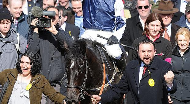 Jockey Ruby Walsh celebrates after winning the Couty Hurdle on Final Approach