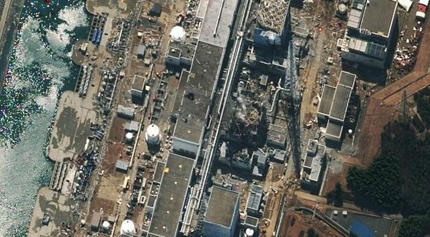 Damage following an earthquake and tsunami to the Fukushima Dai-ichi nuclear power plant in Japan (AP)