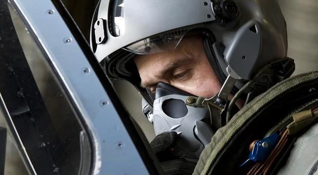 A pilot preparing to take off in a French Mirage 2000 jet fighter at a military base in Dijon (AP)