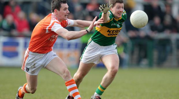 Armagh's Andy Mallon blocks a goal bound shot of Kerry's Kieran O'Leary yesterday but the Kingdom ran out comfortable winners