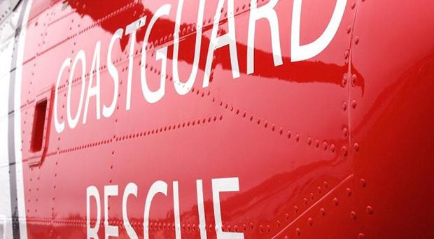 A cargo ship with nine people on board has run aground on a shingle bank, says the Maritime and Coastguard Agency