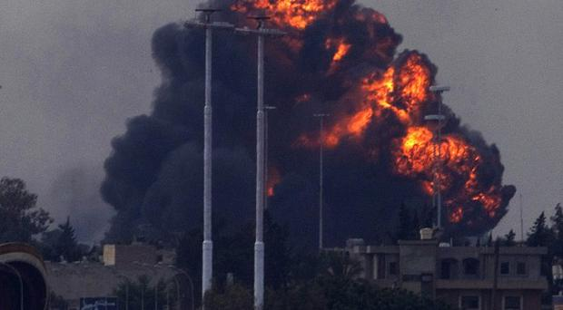 A huge explosion is seen over the outskirts of Benghazi, eastern Libya (AP)