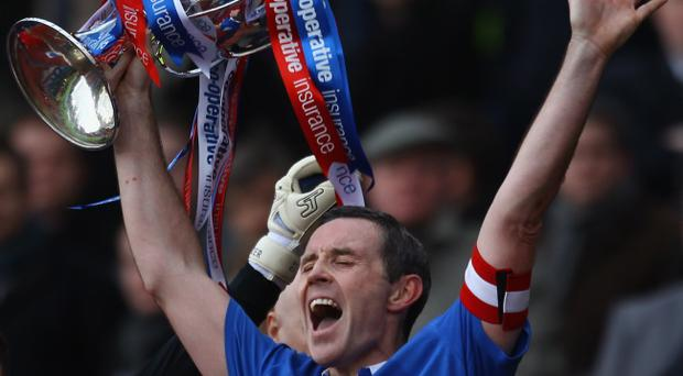 GLASGOW, SCOTLAND - MARCH 20: David Weir captain of Rangers lifts the Co-operative Insurance Cup after beating Celtic in the final at Hampden Park on March 20, 2011 in Glasgow, Scotland. (Photo by Jeff J Mitchell/Getty Images)