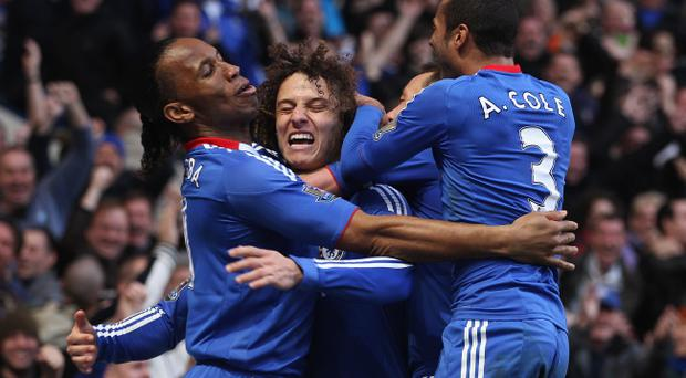 LONDON, ENGLAND - MARCH 20: David Luiz of Chelsea (2L) celebrates with Didier Drogba (L), John Terry (2R) and Ashley Cole (R) as he scores their first goal during the Barclays Premier League match between Chelsea and Manchester City at Stamford Bridge on March 20, 2011 in London, England. (Photo by Scott Heavey/Getty Images)