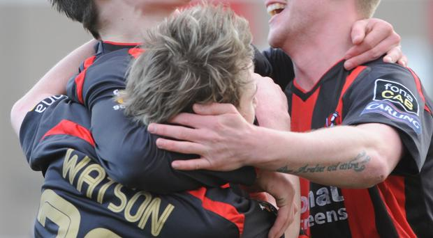 Carling Premier league match between Crusaders and Cliftonville at Seaview Belfast. Crusaders Aiden Watson celebrates