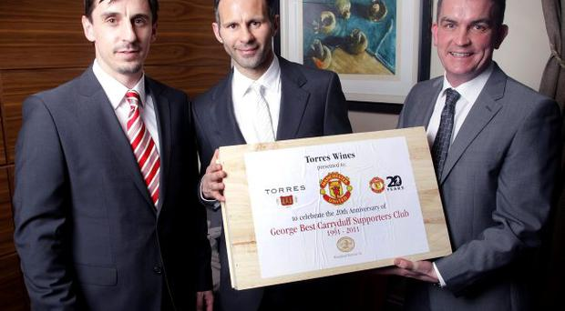 Gift sets are presented to United legends Ryan Giggs and Gary Neville by Gareth Bradley, managing director of wine company Woodford Bourne