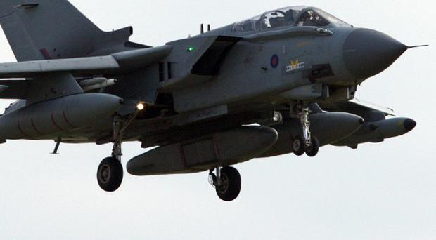 An RAF Tornado GR4 aircraft flies into RAF Marham after allied forces carried out a second night of operations over Libya