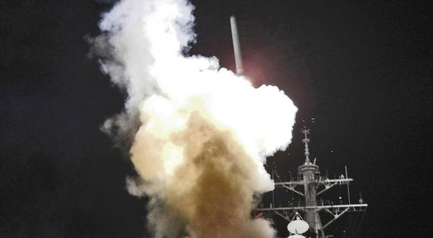 A Tomahawk missile is launched from a US warship in support of Operation Odyssey Dawn from the Mediterranean Sea (AP)
