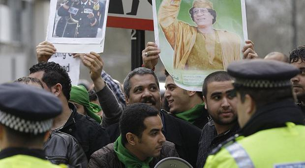 Protesters demonstrate against the bombing of Libya outside the Qatar Embassy in London