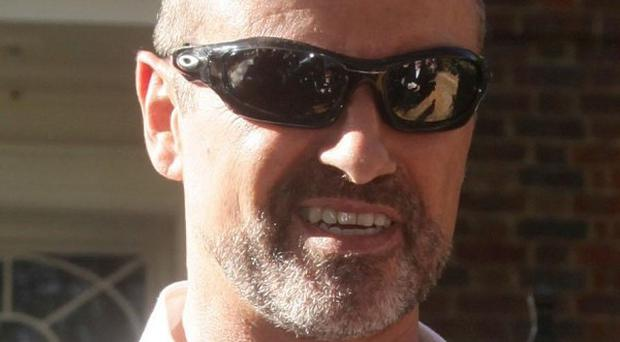 George Michael has suggested he is planning to tour again