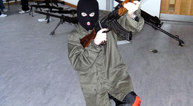 One of a series of pictures posted on a social networking website showing children dressed up as republican paramilitaries in a south Armagh community centre