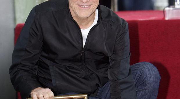 Canadian singer Bryan Adams is honoured with a star on the Hollywood Walk of Fame (AP)